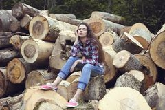 Beautiful youngcountry  woman on firewood background Royalty Free Stock Image