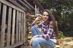 Beautiful youngcountry  woman on firewood background Stock Images