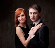 Beautiful youngcouple on grey background Royalty Free Stock Photography