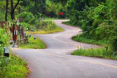 Beautiful zigzag road. Five winding curves. From the top mountain down below Stock Image
