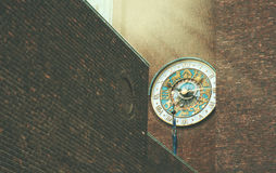 Beautiful zodiac clock on a brick wall of a building in Oslo Stock Image