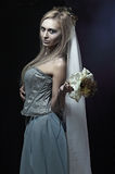 Beautiful zombie corpse bride. Portrait of beautiful zombie corpse bride looked scary and standing at dark background. shot in studio Stock Images