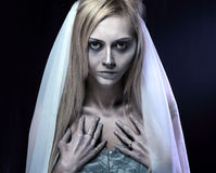 Beautiful zombie corpse bride. Portrait of beautiful zombie corpse bride looked scary and standing at dark background. shot in studio Royalty Free Stock Images