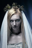 Beautiful zombie corpse bride. Portrait of beautiful zombie corpse bride looked scary and standing at dark background. shot in studio Royalty Free Stock Image