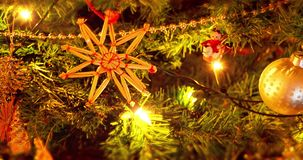 Beautiful zooming close up footage of a Christmas trees with flicking lights and decorations