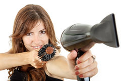 Beautifule female hairdresser using hairdryer and hairbrush Stock Image