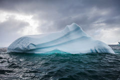 Beautifull big blue iceberg and ocean. Peculiar landscape of Antarctica Royalty Free Stock Photo