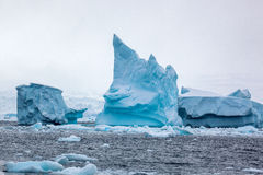 Beautifull big blue iceberg and ocean. Peculiar landscape of Antarctica Stock Image