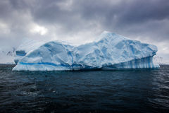 Beautifull big blue iceberg and ocean. Peculiar landscape of Antarctica Royalty Free Stock Photos