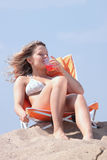 Beautifull blond girl in bikini sunbathing Royalty Free Stock Image