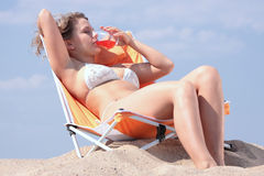 Beautifull blond girl in bikini sunbathing Stock Photos
