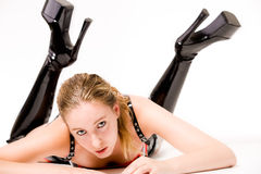Beautifull blond in laque clothing and high heeled royalty free stock images