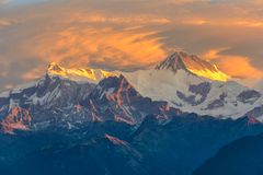 Beautifull cloudy sunrise in the mountains with snow ridge royalty free stock photography
