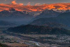 Beautifull cloudy sunrise in the mountains with snow ridge fron Himalaya view point royalty free stock photography
