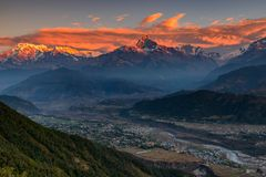 Beautifull cloudy sunrise in the mountains with snow ridge fron Himalaya view point royalty free stock photo