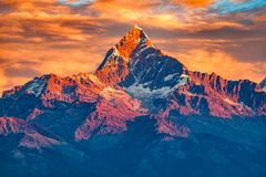Beautifull cloudy sunrise in the mountains with snow ridge fron Himalaya view point. Pokhara Nepal royalty free stock photo