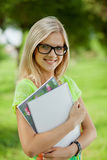 Beautifull college student in park Royalty Free Stock Image