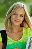 Beautifull college student in park Royalty Free Stock Photo