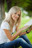 Beautifull college student in park Royalty Free Stock Images