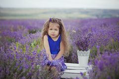 Beautifull cute blond Young beauty girl in blue jeans and purple shirt posing to camera with cosy smile face.Wellbeing time spendi Royalty Free Stock Photography