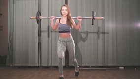 Beautifull girl does attacks with a barbell. 4k stock footage