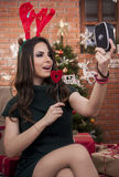 Beautifull girl filming herself. On Chrismas eve stock photography