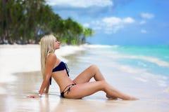 Beautifull girl on the ocean beach. Wonderful morning stock photo