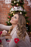 Beautifull girl with the red heart. On Christmas eve royalty free stock photography