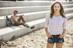 Beautifull girl with skate boyfriend Royalty Free Stock Photography