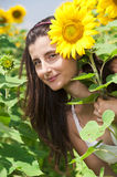 Beautifull girl smile a sunflower field Royalty Free Stock Photo