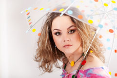 Beautifull girl under polka dotted umbrella Royalty Free Stock Image