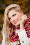 Beautifull happy girl in an autumn park Royalty Free Stock Image
