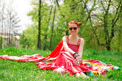 Beautifull happy young woman on green summer grass Royalty Free Stock Photography