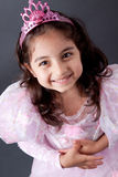 Beautifull Indian girl in Princess outfit. A beautiful girl child smiles as she dresses in her princess costume stock photos