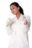 Beautifull Indonesian nurse putting gloves on Stock Photo