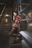 Beautifull lady in leather clothes near city club Royalty Free Stock Photography