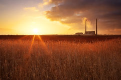 Beautifull landscape with thermal power plant and sunset sky Stock Image