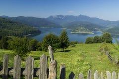 Beautifull landscape. Trees, lake and mountains near Vatra Dornei, Romania Royalty Free Stock Photo