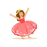 Beautifull little girl princess in a coral red ball dress and golden tiara, fairytale costume for party or holiday Stock Image