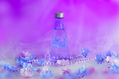 Beautifull perfume background. With packshot and flowers Royalty Free Stock Photography