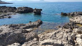 Beautifull picture on the island of kreta. Blue water, lava stone Stock Image