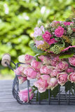 Beautifull pink roses bouquet in a basket Stock Photos