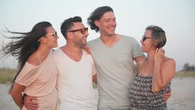 Beautifull portrait of happy active group of people during their vacation in summer time near the sea. stock video footage