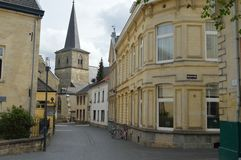 Beautifull Street in Valkenburg background a church Royalty Free Stock Photos