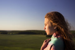 Beautifull teenage girl looking into the distance Royalty Free Stock Image