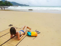 Beautifull woman in bikini lying on tropical beach in Thailand Royalty Free Stock Images