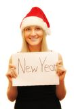 Beautifull woman in christmas cap. Holding card Royalty Free Stock Photography
