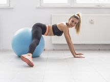 Woman doing exercise on elliptical trainer. Stock Images