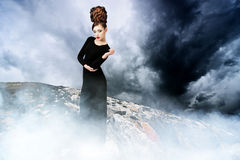 Beautifull woman in foggy landscape Stock Image