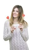 Beautifull woman holding hearts smiling Stock Image